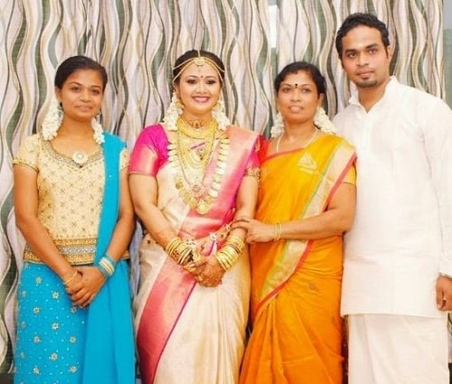 Saranya Sasi with her sister, mother, and brother