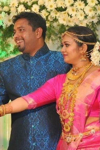 Saranya Sasi and Binu Xavier on their reception day