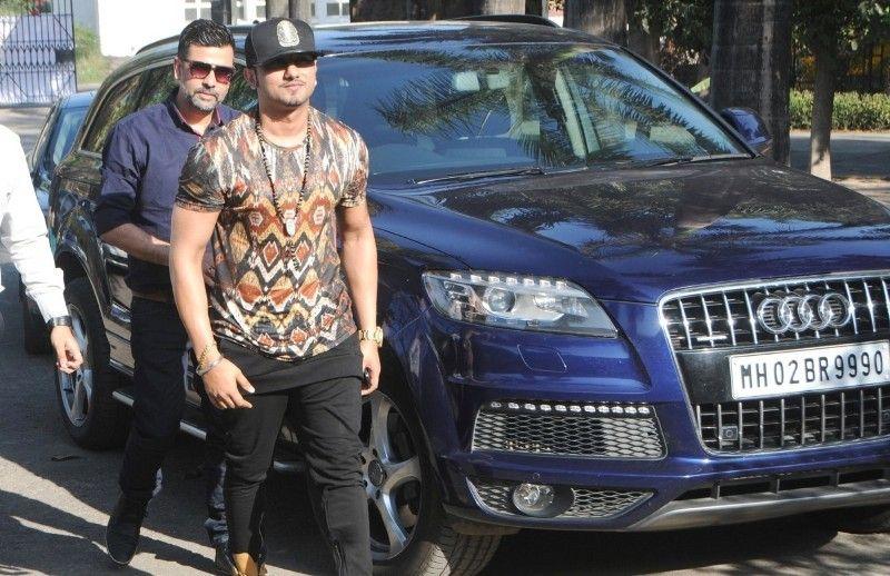 Honey Singh posing with his Audi Q7